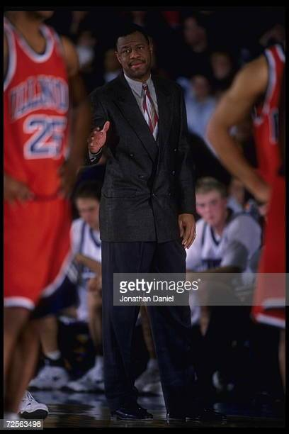 Head coach Ricky Byrdsong of the Northwestern Wildcats is a smooth operator on the sideline during the game against the Illinois Fighting Illini at...