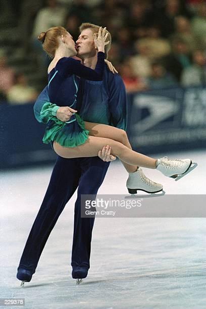 Jenni Meno of West Lake Ohio and Todd Sand of Thousand Oaks California perform their pairs free skate program at the US Figure Skating Championships...