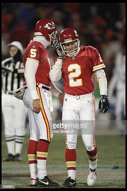 Kansas City Chiefs punter Louis Aguiar consoles teammate kicker Lin Elliott after he missed a field goal during a playoff game against the...