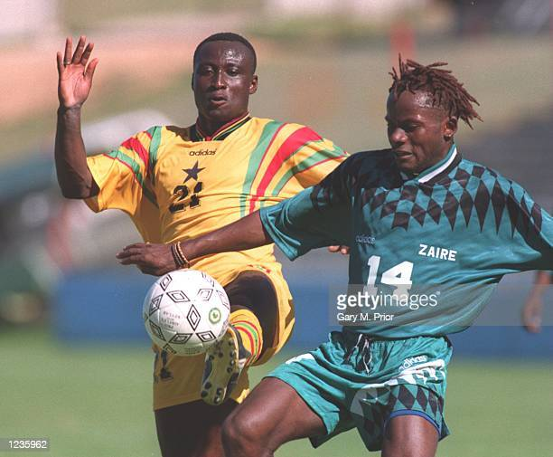 Leeds United player Tony Yeboah playing for Ghana and Zaire's Roger Hitoto in action during Ghana's 10 victory over Zaire in the Quarter Final of the...