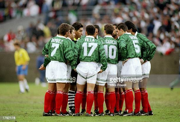 Members of Mexico stand on the field before a Gold Cup game against Brazil at the Los Angeles Memorial Coliseum in Los Angeles California Mexico won...