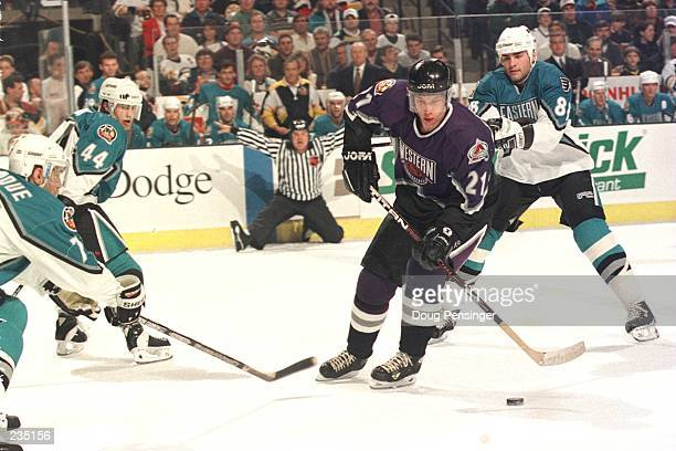 Peter Forsberg of the Western Conference weaves through Ray Bourque Roman Hamrlik and Eric Lindros of the Eastern Conference in an attempt at a shot...