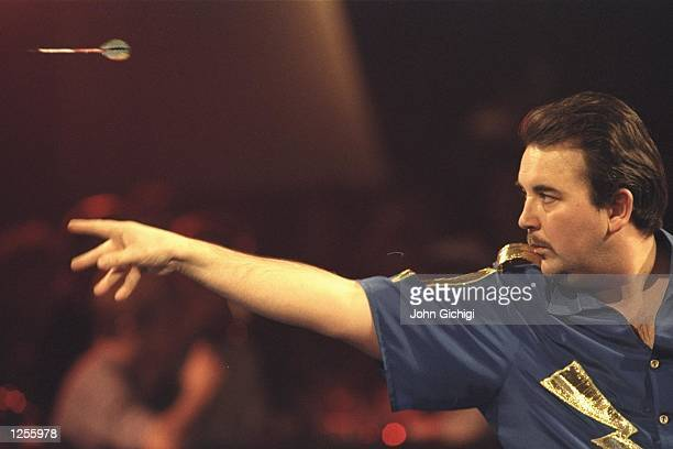 Phil Taylor of England on his way to victory over Dennis Priestly in the final of the Vernon Pools World Darts Championships at Purfleet in Essex...
