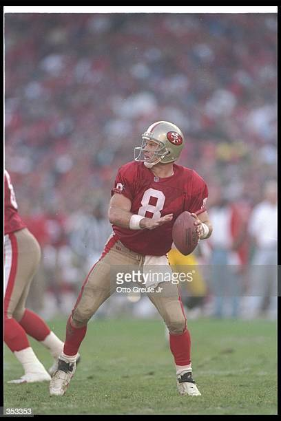 Quarterback Steve Young of the San Francisco 49ers looks to pass the ball during a playoff game against the Green Bay Packers at 3Com Park in San...