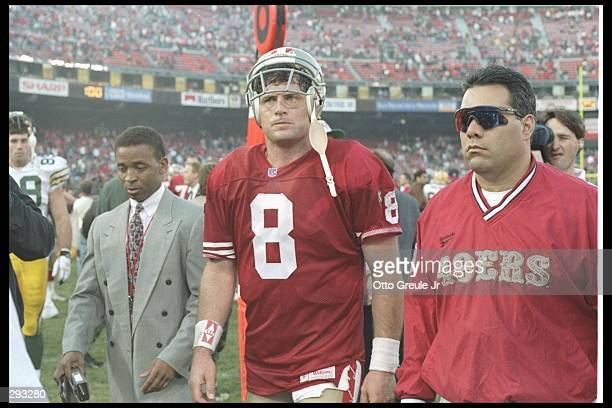 Quarterback Steve Young of the San Francisco 49ers walks off the field after a playoff game against the Green Bay Packers at 3Com Park in San...