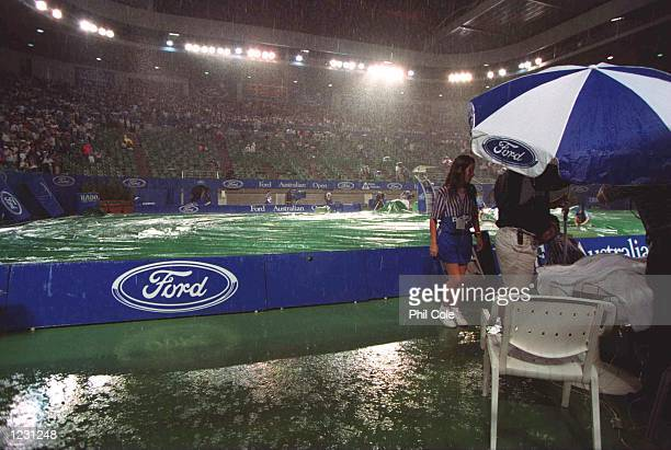 Rain stops play in the match between Andre Agassi of the USA and Jim Courier of the USA in the quarterfinals of the Ford Australian Open at Flinders...