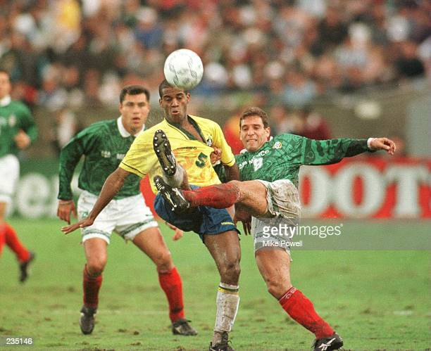 Ricardo Pelaez of Mexico battles with Flavio Conceicao of Brazil for posession of the ball during the Mexico versus Brazil CONCACAF Gold Cup...