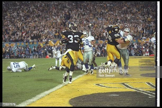 Running back Byron Morris of the Pittsburgh Steelers runs with the ball during Super Bowl XXX against the Dallas Cowboys at Sun Devil Stadium in...