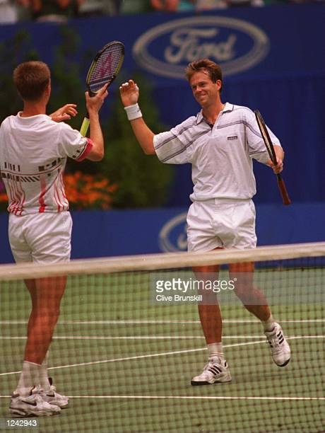 Stefan Edberg of Sweden and Petr Korda of the Czech Republic celebrate after defeating Sebastian Lareau of Canada and Alex O''Brian of the USA to win...