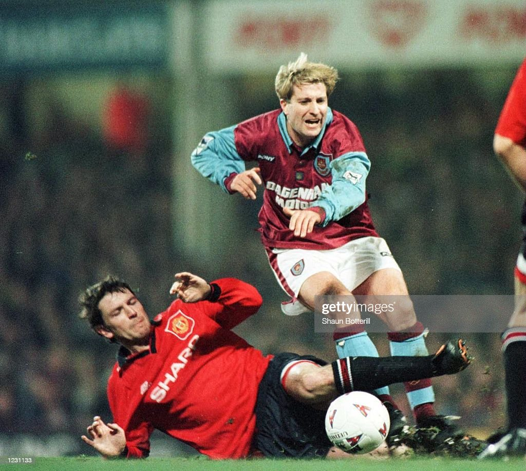 Striker John Moncur of West Ham is brought down by Lee Sharpe of Manchester United during a FA Premiership match against Manchester United at Upton Park in London. Mandatory Credit: Shaun Botterill/Allsport