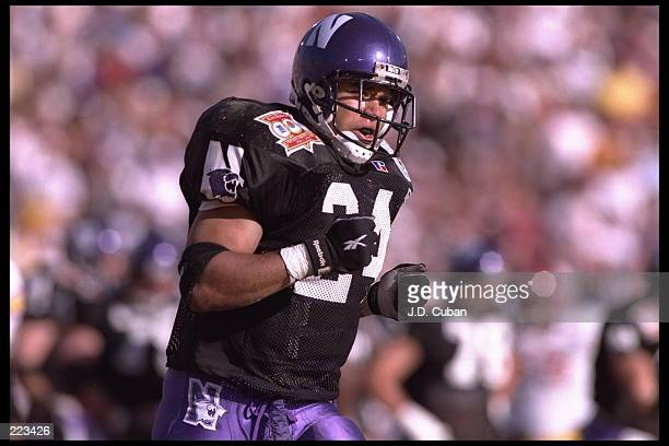 Tailback Darnell Autry of the Northwestern Wildcats jogs back to the bench after scoring a touchdown against the University of Southern California...