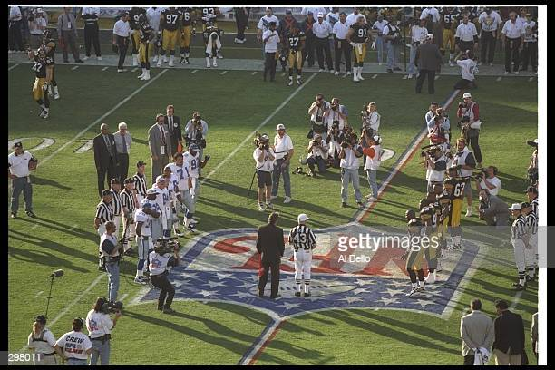 View of the coin toss to start the game between the Dallas Cowboys and Pittsburgh Steelers at Super Bowl XXX at Sun Devil Stadium in Tempe Arizona...