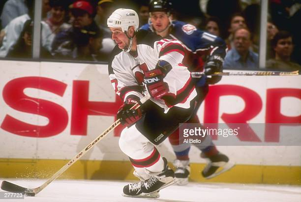 Center Denis Pederson of the New Jersey Devils and Colorado Avalanche rightwinger Keith Jones move down the ice during a game at the Continental...