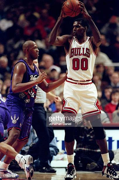 Center Robert Parish of the Chicago Bulls in action against forward Popeye Jones of the Toronto Raptors during a game at the United Center in Chicago...