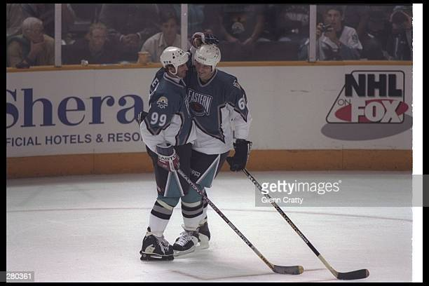 Center Wayne Gretzky of the New York Rangers congratulates center Mario Lemieux of the Pittsburgh Penguins for a goal during the 47th NHL AllStar...
