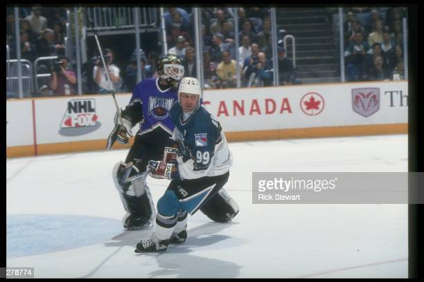 Center Wayne Gretzky of the New York Rangers covers goaltender Andy Moog of the Dallas Stars during the 47th NHL AllStar game at the San Jose Arena...