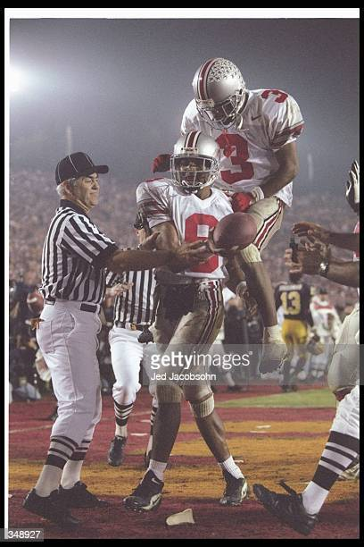 David Boston of the Ohio State Buckeyes celebrates with teammate wide receiver Dimitrious Stanley during the Rose Bowl against the Arizona State Sun...