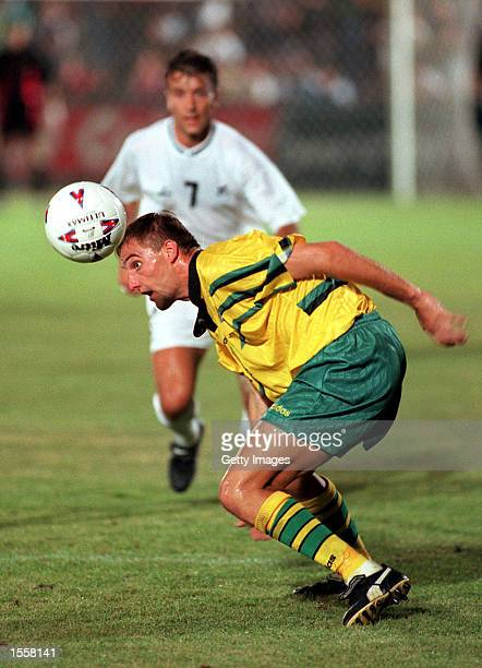 David Zdrilic of Australia heads away the ball as his opponent looks on during the Optus World Soccer Series between Australia and New Zealand played...