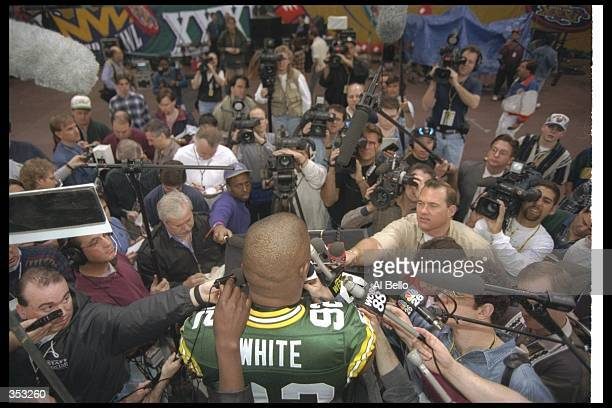 Defensive lineman Reggie White of the Green Bay Packers gets interviewed during Media Day for Super Bowl XXXI against the New England Patriots at the...