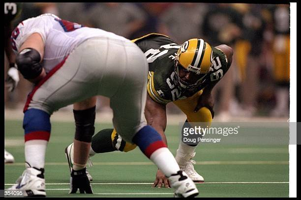 Defensive lineman Reggie White of the Green Bay Packers looks on from his stance during Super Bowl XXXI against the New England Patriots at the...