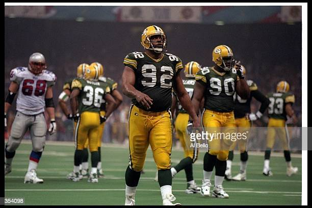 Defensive lineman Reggie White of the Green Bay Packers looks on during Super Bowl XXXI against the New England Patriots at the Superdome in New...