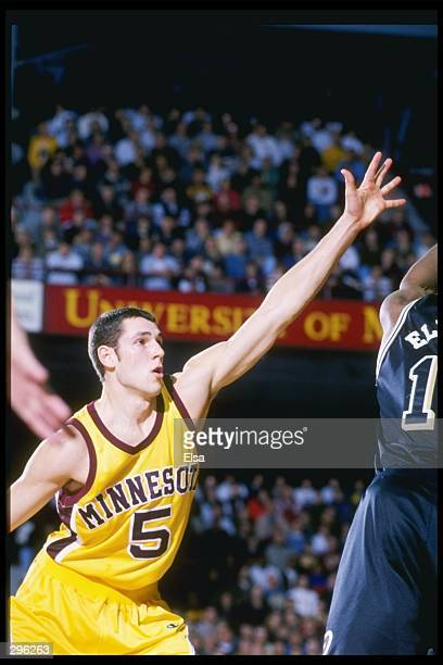 Forward Sam Jacobson of the Minnesota Golden Gophers tries to block the shot of guard Alan Eldridge of the Purdue Boilermakers at the Williams Arena...