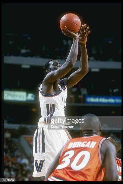 Forward Tim Thomas of the Villanova Wildcats shoots the ball during a game against the Syracuse Orangemen at the CoreStates Center in Philadelphia...
