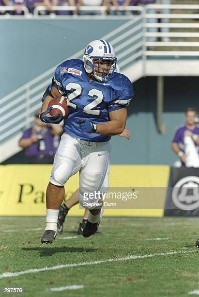 Fullback Mark Atuaia of the Brigham Young Cougars runs down the field during the Cotton Bowl against the Kansas State Wildcats at the Cotton Bowl in...