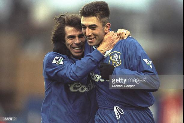 Gianfranco Zola and Roberto Di Matteo of Italy and Chelsea celebrate Di Matteo's goal against Liverpool during the Premier League match at Stamford...