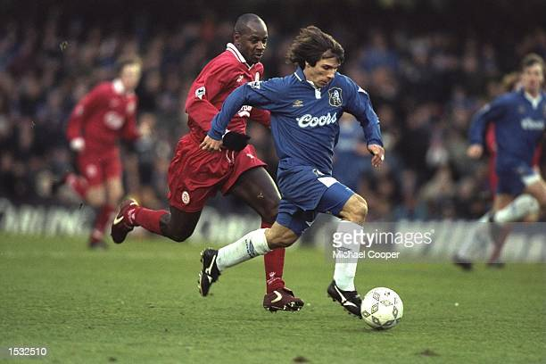 Gianfranco Zola of Italy and Chelsea is tracked by Michael Thomas of Liverpool during the Premier League match at Stamford Bridge, London. Chelsea...
