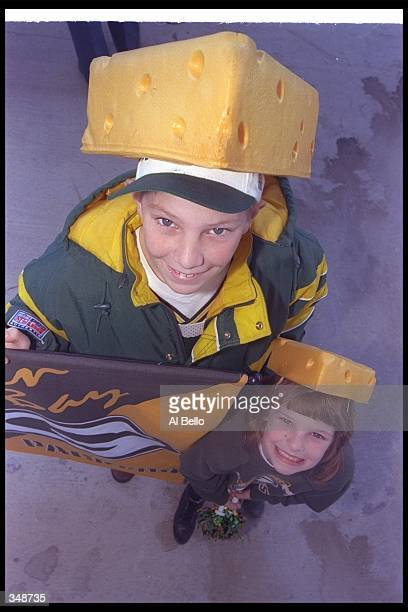 Green Bay Packers fans celebrate before Super Bowl XXXi against the New England Patriots at the Superdome in New Orleans Louisiana The Packers won...