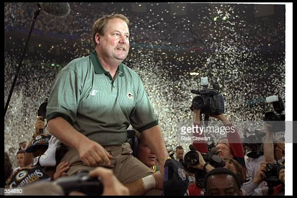 Green Bay Packers head coach Mike Holmgren celebrates after Super Bowl XXXI against the New England Patriots at the Superdome in New Orleans,...