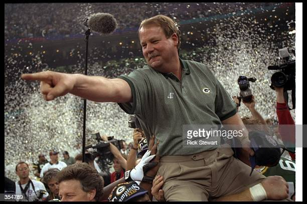 Green Bay Packers head coach Mike Holmgren celebrates after Super Bowl XXXI against the New England Patriots at the Superdome in New Orleans...