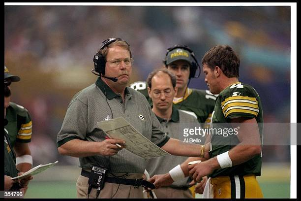 Green Bay Packers head coach Mike Holmgren confers with quarterback Brett Favre during Super Bowl XXXI against the New England Patriots at the...