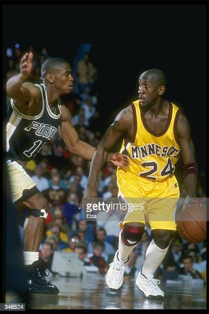 Guard Bobby Jackson of the Minnesota Golden Gophers moves the ball as Purdue Boilermakers guard Alan Eldridge covers him during a game at Williams...