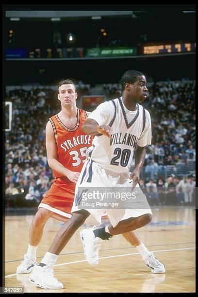 Guard Jason Cipolla of the Syracuse Orangemen covers Villanova Wildcats guard Alvin Williams during a game at the CoreStates Center in Philadelphia...