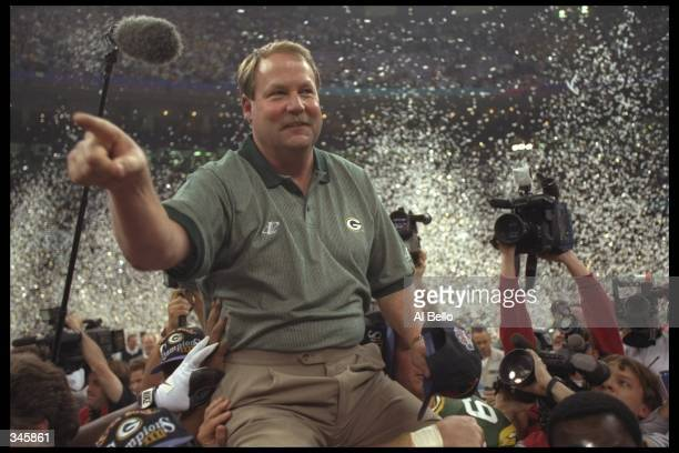 Head coach Mike Holmgren of the Green Bay Packers is carried off the field after the Packers 3521 victory over the New England Patriots in Super Bowl...