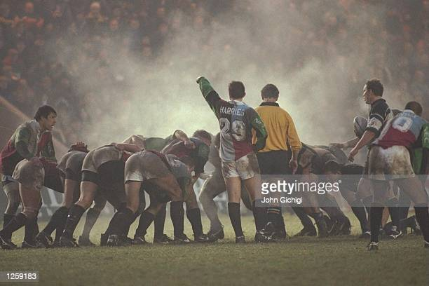 Huw Harries of Harlequins keeps an eye on the steaming pack during the Courage League division one match between Harlequins and Bath at the Stoop in...