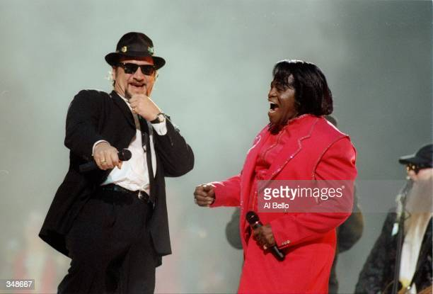 James Belushi and James Brown perform during the half-time show for Super Bowl XXXI between the New England Patriots and the Green Bay Packers at the...
