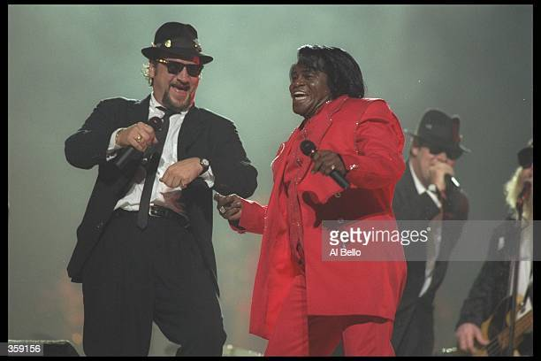 James Belushi and James Brown perform in the half time show during Super Bowl XXXI at the Louisiana Superdome in New Orleans Louisiana Mandatory...