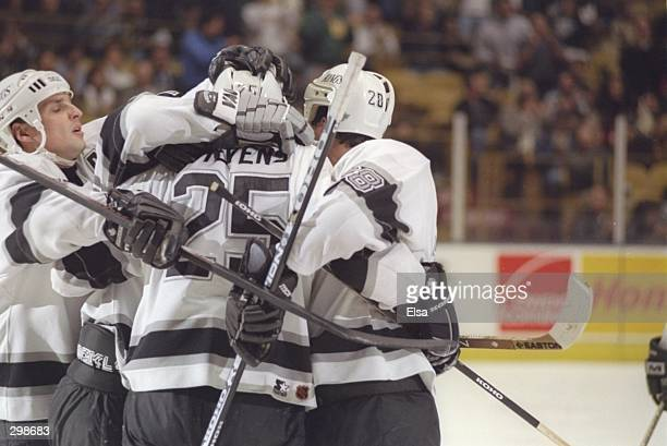 Leftwinger Kevin Stevens of the Los Angeles Kings is congratulated by his fellow players for a goal against the Vancouver Canucks during a game at...