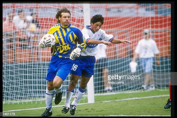 Luis Diaz of U Catolica and Garlos Prono of Olimpia fight for the ball during a Copa Cup game at the Orange Bowl in Miami Florida U Catolica won the...