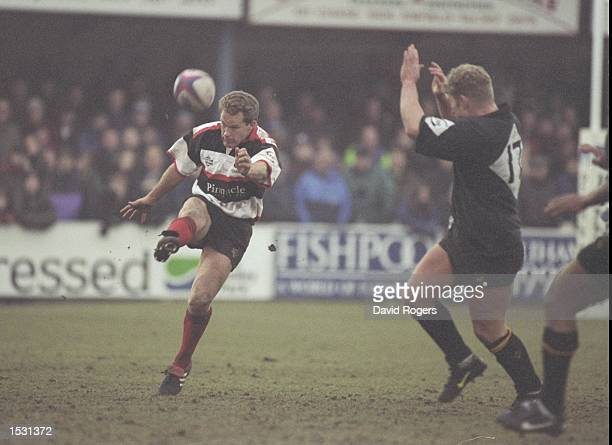 Michael Lynagh of Saracens kick for touch during the Pilkington Cup 5th round match against Wasps at Enfield, London. Saracens beat Wasps 21-17....