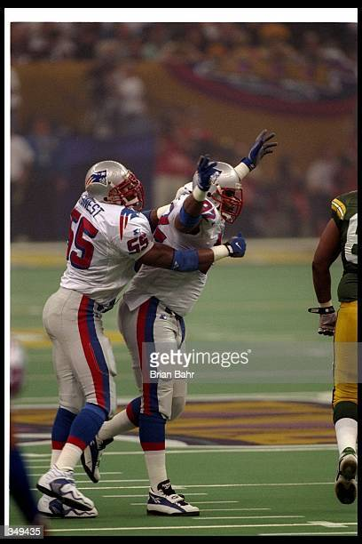 New England Patriots defensive linemen Willie McGinest and Ferric Collons celebrate during Super Bowl XXXI against the Green Bay Packers at the...