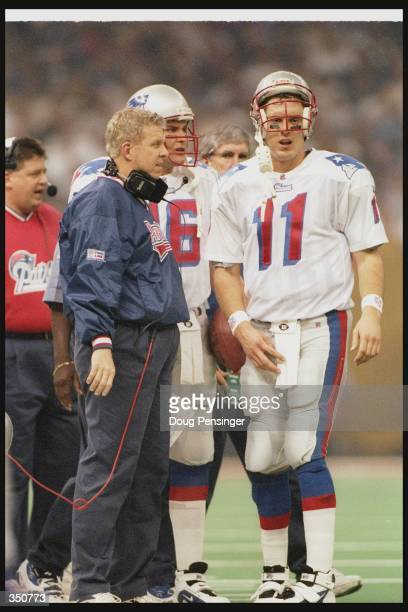 New England Patriots head coach Bill Parcells confers with quarterback Drew Bledsoe during Super Bowl XXXI against the Green Bay Packers at the...