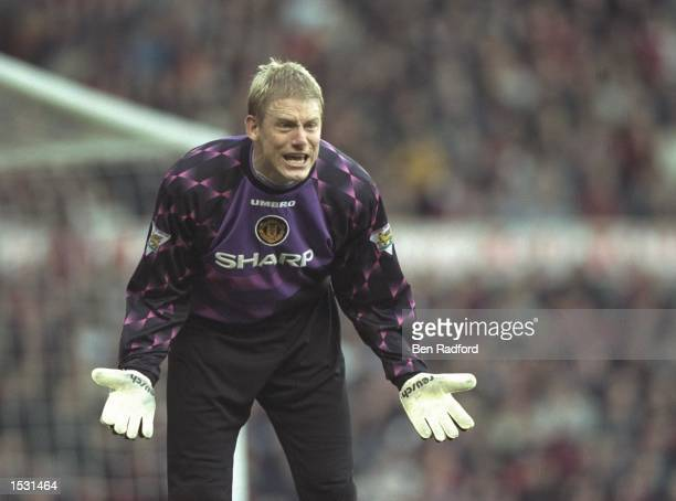 Peter Schmeichel of Manchester United pleads to his teammates during the FA cup fourth round tie between Manchester United and Wimbledon at Old...