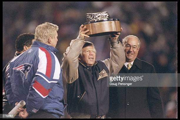 President/CEO Robert K Kraft of the New England Patriots receives the AFC Championship trophy for victory over the Jacksonville Jaguars in the AFC...
