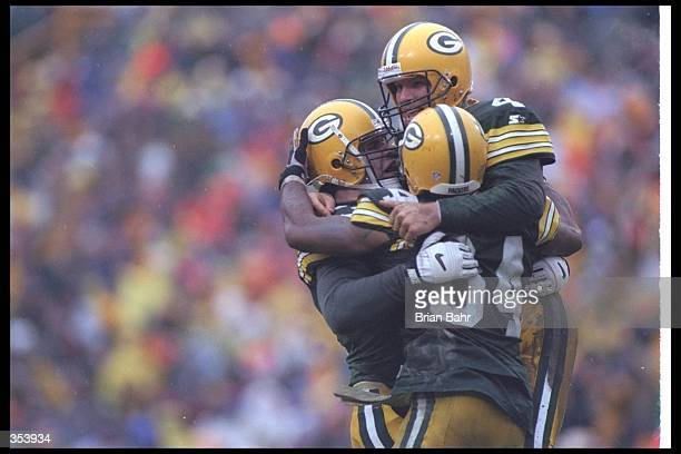 Quarterback Brett Favre of the Green Bay Packers celebrates with teammates during a playoff game against the San Francisco 49ers at Lambeau Field in...