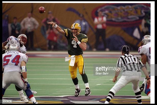 Quarterback Brett Favre of the Green Bay Packers passes the ball during Super Bowl XXXI against the New England Patriots at the Superdome in New...