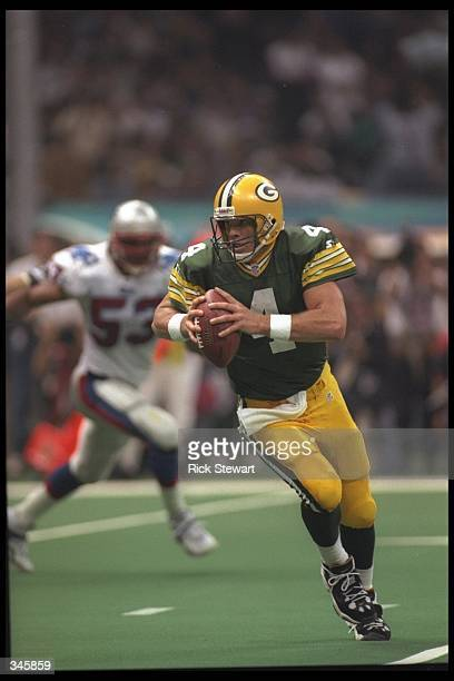 Quarterback Brett Favre of the Green Bay Packers runs in to score a 2 yard touchdown against the New England Patriots during the Packers 3521 win...